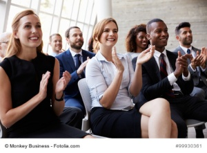 Audience Applauding Speaker At Business Conference